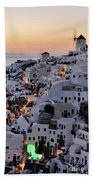 Oia Town During Sunset Beach Towel