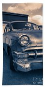 Old Car In Front Of Garage Beach Towel