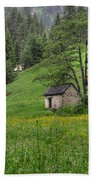 Old House On The Green Field Beach Towel