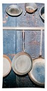 Old Kitchen Utensils On Soot-black Wall Beach Towel