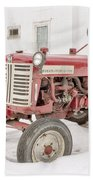 Old Red Tractor In The Snow Beach Towel