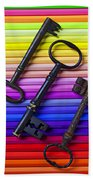 Old Skeleton Keys On Rows Of Colored Pencils Beach Towel