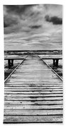 Old Wooden Jetty During Storm On The Sea Beach Towel