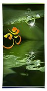 Om On Green With Dew Drop Beach Towel