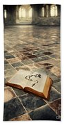 Open Book And Roasary On The Floor Beach Towel
