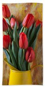 Orange Tulips In Yellow Pitcher Beach Towel by Garry Gay