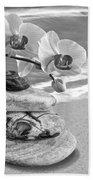 Orchids And Pebbles On The Sand In Black And White Beach Towel