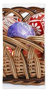 painted Easter Eggs in wicker basket Beach Towel