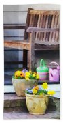 Pansies And Watering Cans On Steps Beach Sheet