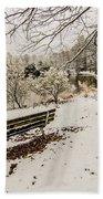 Park Bench In The Snow Covered Park Overlooking Lake Beach Towel