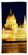 Parliament Building At Night In Budapest Beach Towel