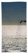 Pelicans In Flight Beach Towel