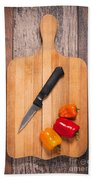 Peppers And Knife On Cutting Board Beach Sheet
