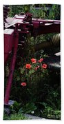 Poppies Growing Amongst Farm Machinery In A Farmyard Near Pocklington Yorkshire Wolds East Yorkshire Beach Towel