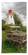 Prince Edward Island Lighthouse With Lobster Traps Beach Towel by Edward Fielding