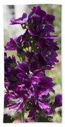 Purple Hollyhock Flowers Beach Towel