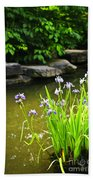 Purple Irises In Pond Beach Towel by Elena Elisseeva