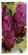 Purple Orchids With Bokeh Beach Towel