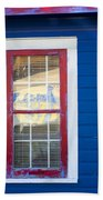 Red And White Window In Blue Wall Beach Towel