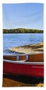 Red Canoe On Shore Beach Towel