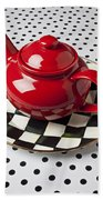 Red Teapot On Checkerboard Plate Beach Towel