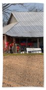Red Tractor In A Tin Roofed Shed Beach Towel