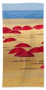 Red Umbrellas Beach Towel by Carlos Caetano