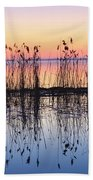 Reeds Reflected In Water At Dusk Ile Beach Towel