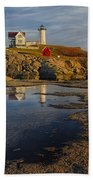 Reflecting On Nubble Lighthouse Beach Towel by Susan Candelario