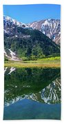 Reflection Of Mountains In Tern Lake Beach Towel