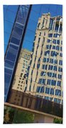 Reflections In The Rolex Bldg. Beach Towel