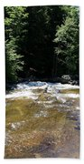River Running Over Rocks Beach Towel