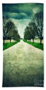 Road Lined By Trees Beach Towel