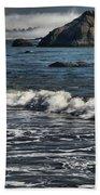 Rocks In The Surf Beach Towel