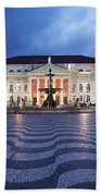 Rossio Square At Night In Lisbon Beach Towel