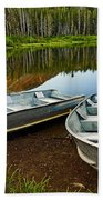 Row Boats Lining A Lake In Mammoth Lakes California Beach Towel