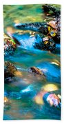 Rushing Water Over Fall Leaves Beach Towel