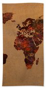Rusty Vintage World Map On Old Metal Sheet Wall Beach Towel by Design Turnpike