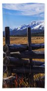 Sawtooth Mountains And Wooden Fence Beach Towel
