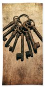 Set Of Old Rusty Keys On The Metal Surface Beach Towel