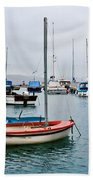 Small Boats At Lyme Regis Harbour Beach Towel