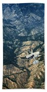 Small Plane Flying Over Mountains Beach Towel
