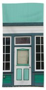 Small Store Front Entrance To Green Wooden House Beach Towel