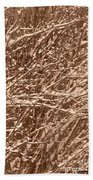 Snow Covers A Tree Branch In Winter Beach Towel