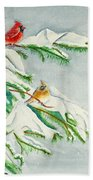 Snowy Pines And Cardinals Beach Towel