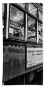 St. Charles Ave Streetcar Whizzes By-black And White Beach Towel