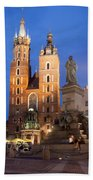 St Mary Basilica And Adam Mickiewicz Monument At Night In Krakow Beach Towel