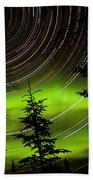 Star Trails And Northern Lights In Sky Over Taiga Beach Towel