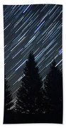 Star Trails And Pine Trees Beach Towel