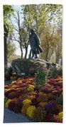 Statue And Flower Bed Across The Street From The Grand Palais Off Of Champs Elysees Beach Towel